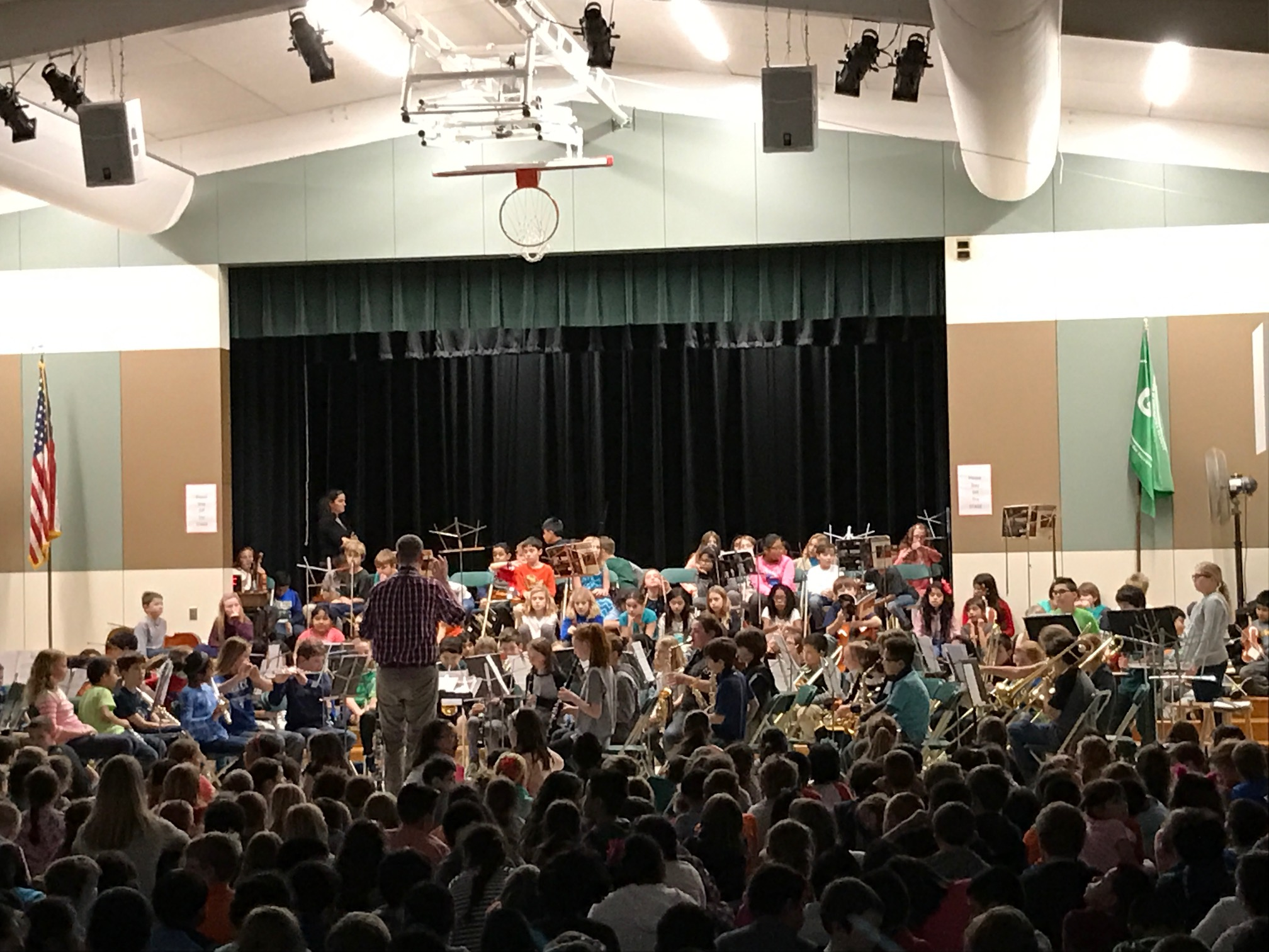 elementary school band performing for an audience