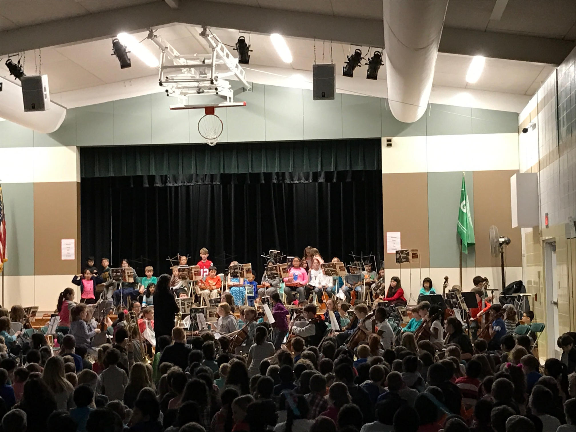 elementary school orchestra performing in front of an audience