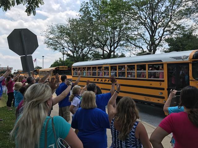 teachers waving